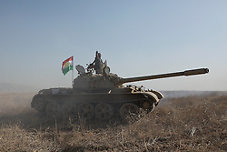 20/10/2016. Bashiqa, Iraq. A Kurdish T-55 tank advances as peshmerga fighters start a large offensive to retake the Bashiqa area from Islamic State militants today (20/10/2016).<br /> <br /> Launched in the early hours of today with support from coalition special forces and air strikes, the attack is part of the larger operation to retake Mosul from the Islamic State, and involves both the Kurds and the Iraqi Army. The city of Bashiqa, around 9 miles north of Mosul, is one of several gateway areas that must be taken before any attempted offensive on Mosul itself.<br /> <br /> Despite the peshmerga suffering several casualties after militants fought back using mortars, heavy machine guns and snipers, the Kurdish forces were quickly taking ground with Haider al-Abadi, the Iraqi prime minister, stating that the operation to retake Mosul was progressing faster than expected. Photo credit: Matt Cetti-Roberts/LNP