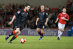 Image ©Licensed to i-Images Picture Agency. 07/08/2014. Salford, United Kingdom. Class of 92 Manchester. AJ Bell Stadium. Jack Whitehall on the ball . Class of 92 squad play Salford City FC at the AJ Bell Stadium . Picture by i-Images