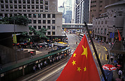 The Chinese flag hangs over Central, on the eve of the handover of sovereignty from Britain to China, on 30th June 1997, in Hong Kong, China.  Midnight signified the end of British rule, and the transfer of legal and financial authority back to China. Hong Kong was once known as 'fragrant harbour' (or Heung Keung) because of the smell of transported sandal wood.
