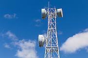microwave parabolic dish antenna radio link on lattice tower against clouds in Gumlu, Queensland, Australia