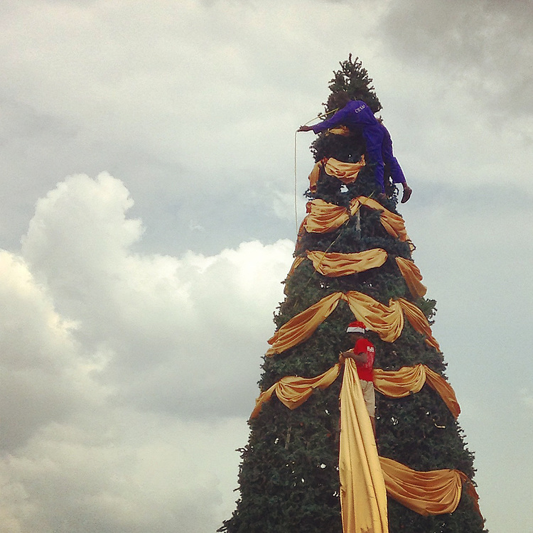 The annual Christmas tree goes up in one of the roundabouts near downtown Kigali, Rwanda, on Dec. 1, 2014.