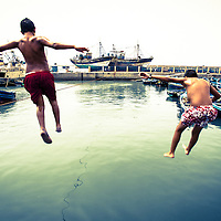 Boys at play in Essaouira fishing port, Morocco