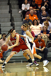 20 March 2010: Alex Hoover looks for a way around Liz Ellis. The Flying Dutch of Hope College fall to the Bears of Washington University 65-59 in the Championship Game of the Division 3 Women's NCAA Basketball Championship the at the Shirk Center at Illinois Wesleyan in Bloomington Illinois.