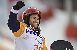 PYEONGCHANG, March 12, 2018  Mike Schultz from the United States celebrates during the awarding ceremony for the Men's Snowboard Cross SB-LL1 event of the 2018 PyeongChang Winter Paralympic Games at Jeongseon Alpine Centre, South Korea, March 12, 2018. Mike Schultz claimed the title of the event. (Credit Image: © Xia Yifang/Xinhua via ZUMA Wire)