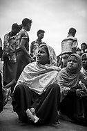 Rohingya men and women wait in line for an aid distribution at Chakmarkul refugee camp, Bangladesh (October 28, 2017)