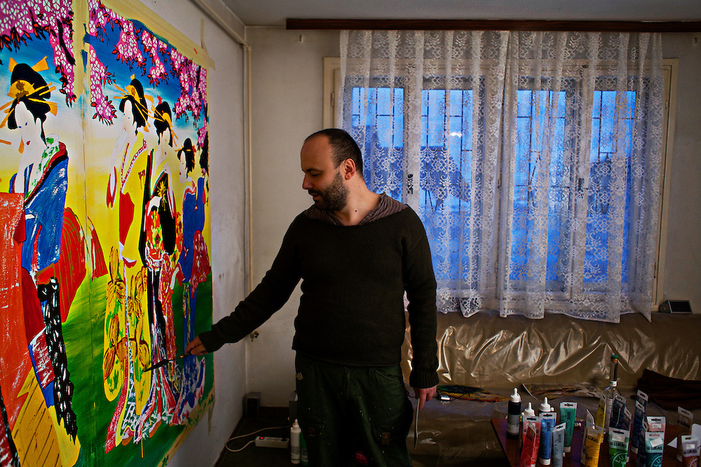 "Muhamed ""Muha"" Kafedzic works on a series of paintings in his Sarajevo studio, which is on the ground floor of his apartment building. He secludes himself to work on his project of making modern, personally-touched reproductions of ancient Japanese paintings. His passion for science fiction and comics emerges in much of his work. This passion extends from the war years where he would pass around VHS tapes with his friends of the latest comics and movies and wait patiently for the electricity to come back on so he could escape in to these other worlds.."
