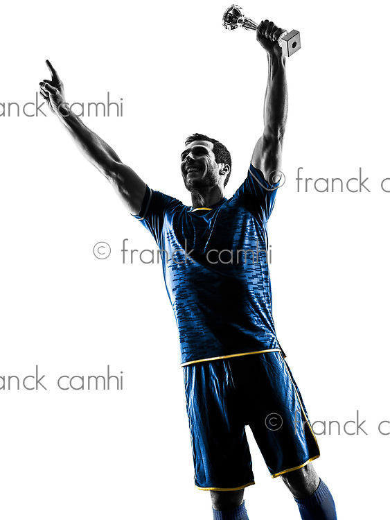 one caucasian soccer player man happy celebration trophy cup   in silhouette isolated on white background