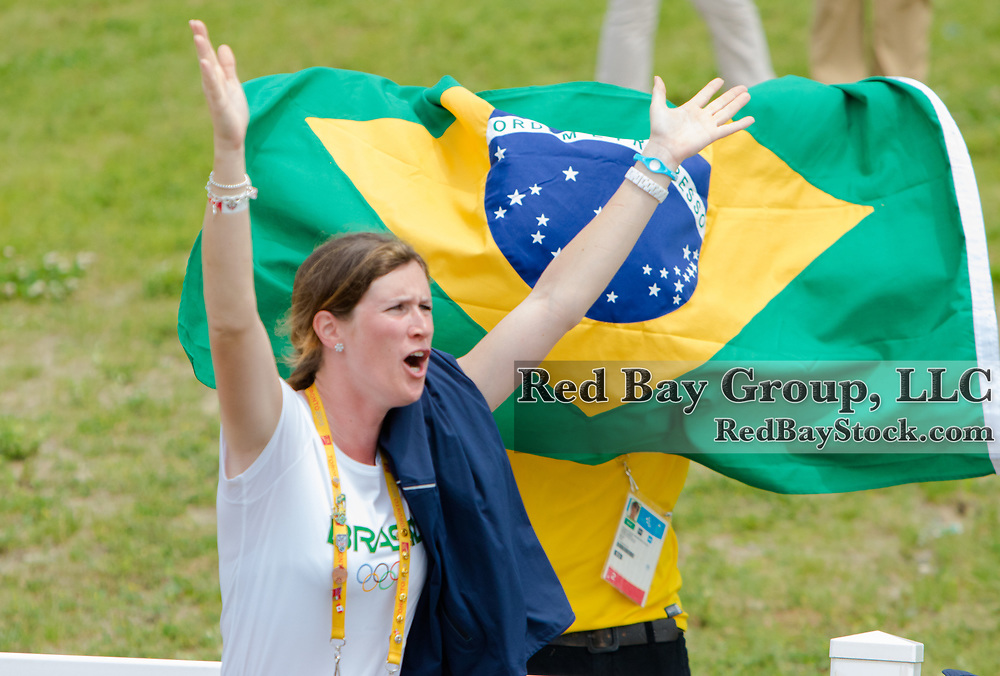 Sarah Elizabeth Waddell (BRA) cheering on fellow team member, Leandro Aparecido da Silva on Di Caprio at the OLG Caledon Pan Am Equestrian Park during the Toronto 2015 Pan American Games in Caledon, Ontario, Canada.