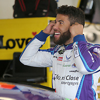 Darrell Wallace Jr. preps himself during practice for the 60th Annual NASCAR Daytona 500 auto race at Daytona International Speedway on Friday, February 16, 2018 in Daytona Beach, Florida.  (Alex Menendez via AP)