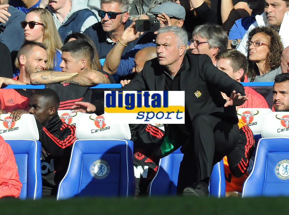 Football - 2018 / 2019 Premier League - Chelsea vs. Manchester United<br /> <br /> Jose Mourinho Manager of  Manchester United leaps from his seat, at Stamford Bridge.<br /> <br /> <br /> COLORSPORT/ANDREW COWIE