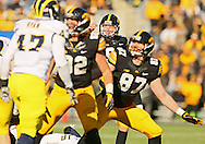 November 23 2013: Iowa Hawkeyes kicker Mike Meyer (96) watches a kick during the first quarter of the NCAA football game between the Michigan Wolverines and the Iowa Hawkeyes at Kinnick Stadium in Iowa City, Iowa on November 23, 2013. Iowa defeated Michigan 24-21.
