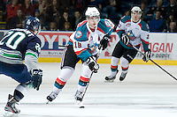 KELOWNA, CANADA, JANUARY 27: Brett Bulmer #19 of the Kelowna Rockets skates with the puck as the Seattle Thunderbirds visit the Kelowna Rockets on January 27, 2012 at Prospera Place in Kelowna, British Columbia, Canada (Photo by Marissa Baecker) *** Local Caption ***