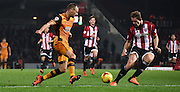 David Meyler looks to turn James Tarkowski during the Sky Bet Championship match between Brentford and Hull City at Griffin Park, London, England on 3 November 2015. Photo by Michael Hulf.