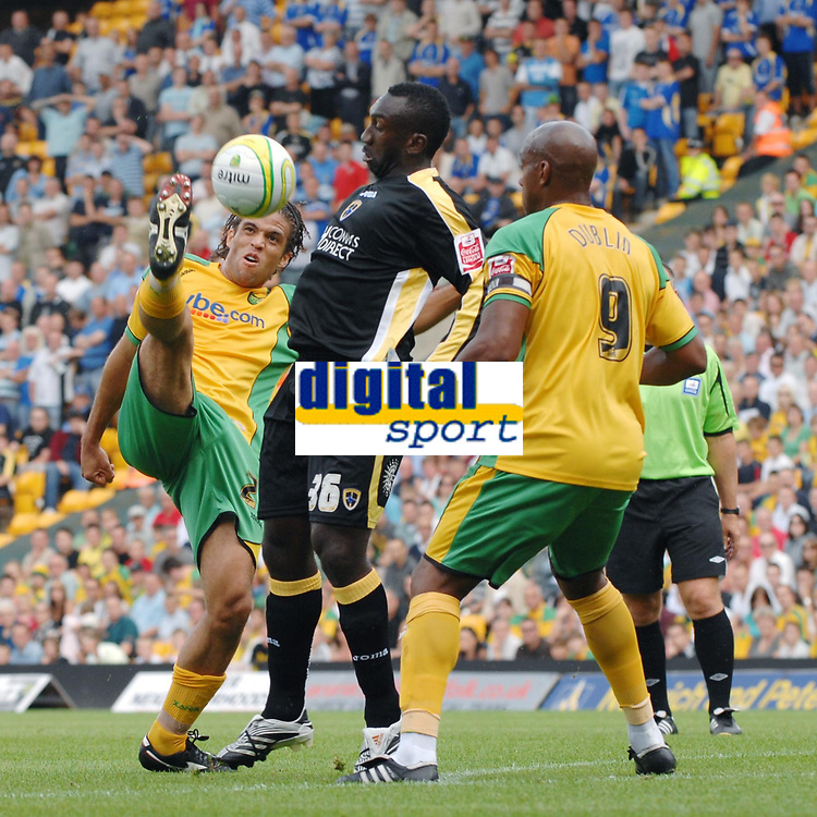 Photo: Ashley Pickering.<br /> Norwich City v Cardiff City. Coca Cola Championship. 01/09/2007.<br /> Darel Russell (L) and Dion Dublin (R) of Norwich keep a close eye on Jimmy-Floyd Hasselbaink of Cardiff