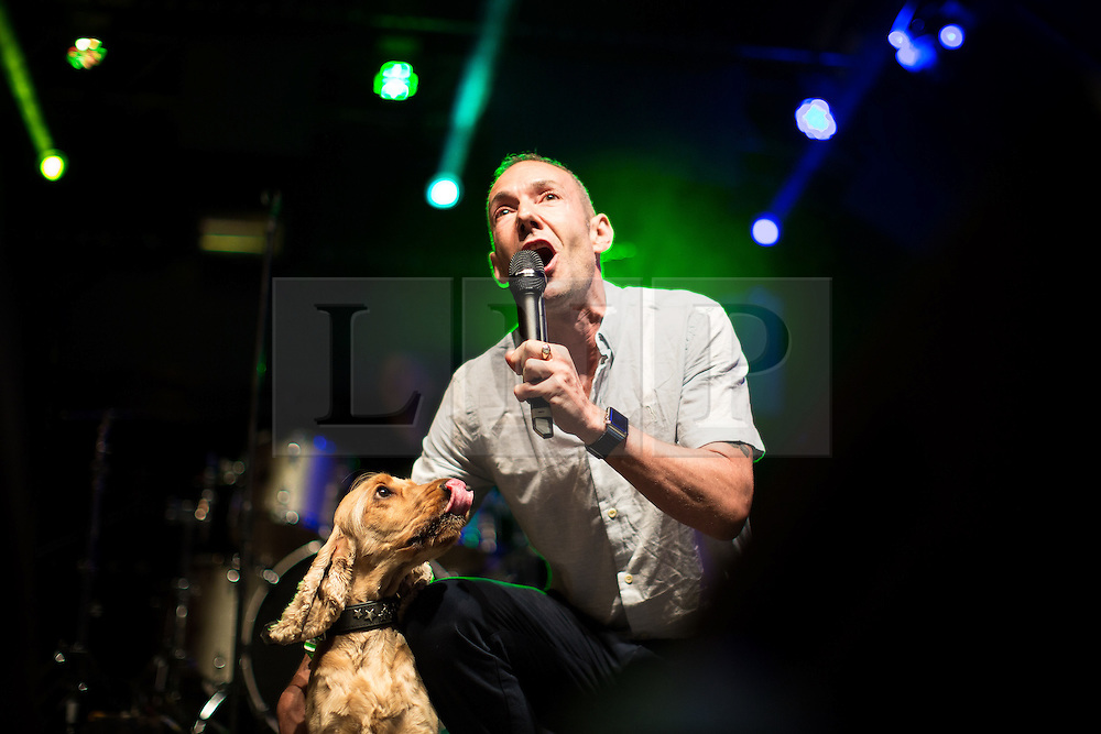 © Licensed to London News Pictures . 26/08/2016 . Manchester , UK . JEREMY JOSEPH , owner of G-A-Y , on the main stage with his dog at Manchester's Gay Village for 2016 Manchester Gay Pride Big Weekend . Photo credit : Joel Goodman/LNP
