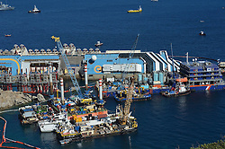 60484301 Isola del Giglio, Italy. Work begins today to right the stricken Costa Concordia vessel, which sank on January 12, 2012. If the operation is successful, it will then be towed away and scrapped. The procedure, known as parbuckling, has never been carried out on a vessel as large as Costa Concordia before, Italy, Monday September 16, 2013.<br /> Picture by imago / i-Images<br /> UK ONLY