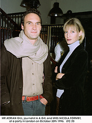 MR ADRIAN GILL, journalist A A Gill, and MISS NICOLA FORMBY, at a party in London on October 30th 1996. <br /> LTC 20
