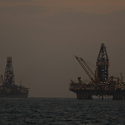 The Transocean Development Driller III and Transocean Discoverer Enterprise drill ship are seen at the BP Plc Macondo well site in the Gulf of Mexico off the coast of Louisiana, U.S., on Friday, July 30, 2010. BP Plc continues to work on a relief well to permanently plug the source of the largest oil spill in U.S. history.  Photographer: Derick E. Hingle/Bloomberg