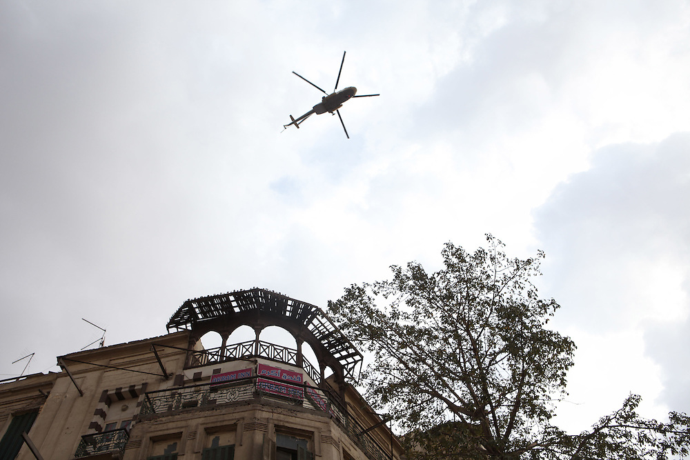 An Egyptian army helicopter flies overhead Cairo's main Tahrir (Liberation) Square.