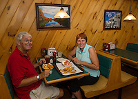 Ed Dailey with his cousin Bev Gebicke visiting from Ninety Six, SC enjoy scallops, a lobster roll and onion rings for lunch at Sawyers Dairy Bar on Thursday afternoon.  (Karen Bobotas/for the Laconia Daily Sun)