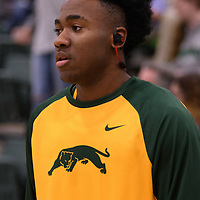 1st year guard Johneil Johnson (3) of the Regina Cougars warms up the home opener  on November  4 at Centre for Kinesiology, Health and Sport. Credit: /Arthur Images