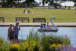 © Licensed to London News Pictures. 19/07/2016. Southsea, United Kingdom.  People enjoying the heatwave on Southsea canoe lake this afternoon, 19th July 2016. Photo credit: Rob Arnold/LNP