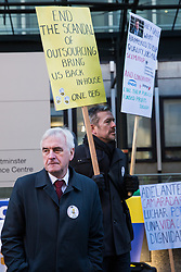 London, UK. 22nd January, 2019. Shadow Chancellor John McDonnell shows solidarity for support staff at the Department of Business, Energy and Industrial Strategy (BEIS) represented by the Public and Commercial Services (PCS) union on the picket line after beginning a strike for the London Living Wage of £10.55 per hour and parity of sick pay and annual leave allowance with civil servants. The strike is being coordinated with receptionists, security staff and cleaners at the Ministry of Justice (MoJ) represented by the United Voices of the World (UVW) trade union.