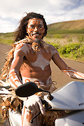 Indigenous Rapa Nui man on scooter, Easter Island, Chile