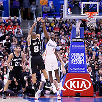 18 February 2014: San Antonio Spurs point guard Patty Mills (8) takes a three point jumpshot over Los Angeles Clippers point guard Darren Collison (2) during the San Antonio Spurs 113-103 victory over the Los Angeles Clippers at the Staples Center, Los Angeles, California, USA.