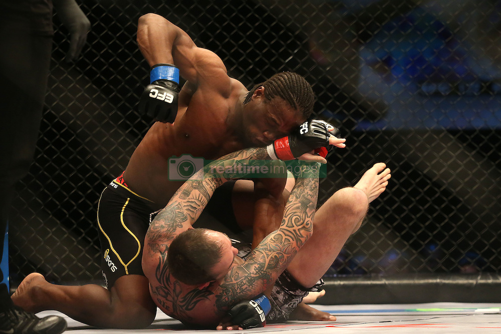 Bruno Mukulu (Blue) attacks Wade Henderson (Red) during the ninth bout of the Extreme Fighting Championships, EFC 52 held at the Grand West Casino in Cape Town, South Africa on the 5th August 2016<br /> <br /> Photo by:   Shaun Roy / Real Time Images
