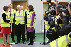 © Licensed to London News Pictures. 29/02/2016. Antrim, Northern Ireland, Mayor of London, Boris Johnson MP, is greeted by the Northern Ireland First Minister Arlene Foster and Secretary of State Theresa Villiers before a tour of Wrightbus plant in Antrim,  Northern Ireland. Boris was visiting businesses that are supported by investment from Transport for London. Photo credit : Paul McErlane/LNP