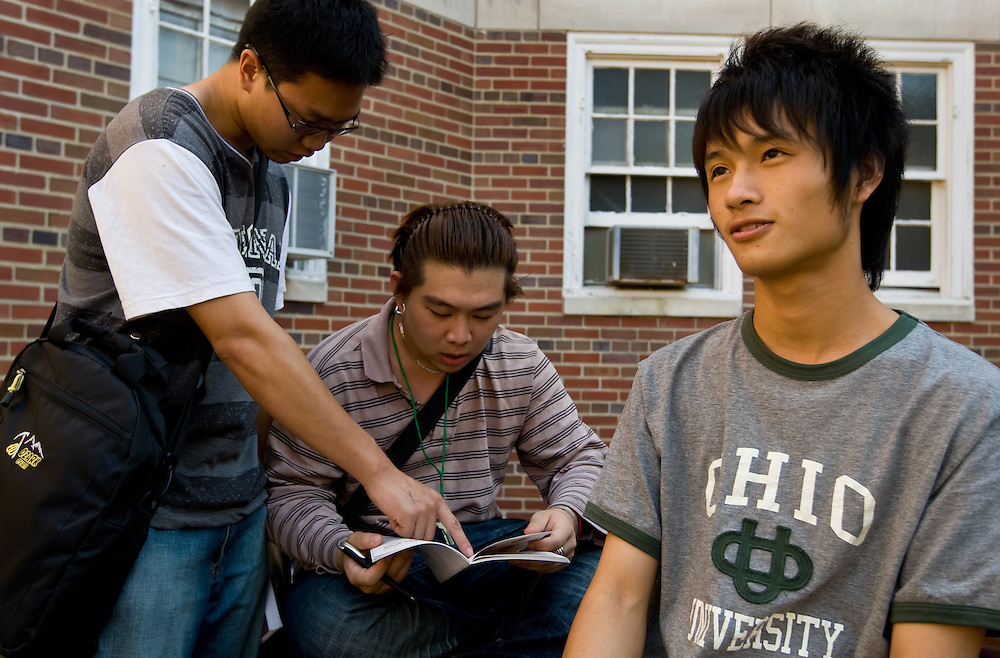 08-19070    Chinese foreign students, (from left) Weijia Zhang, Yiu Yang Liu and Tian Lei Zhou, hangout outside Scott Squad, on Wednesday, September 24...(The last name cannot be found on the directory, but that's what he wrote)