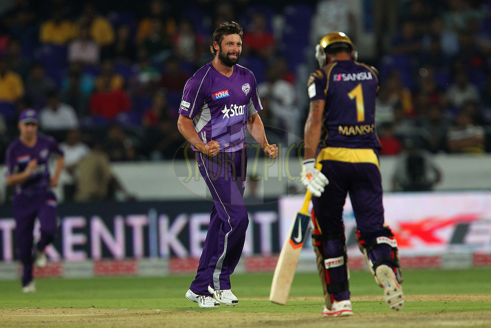 Ben HILFENHAUS of the Hobart Hurricanes celebrates the wicket of Manish PANDEY of the Kolkata Knight Riders in vain as the delivery was a NO BALL during the first semi final match of the Oppo Champions League Twenty20 between the Kolkata Knight Riders and the Hobart Hurricanes held at the Rajiv Gandhi Cricket Stadium, Hyderabad, India on the 2nd October 2014<br /> <br /> Photo by:  Ron Gaunt / Sportzpics/ CLT20<br /> <br /> <br /> Image use is subject to the terms and conditions as laid out by the BCCI/ CLT20.  The terms and conditions can be downloaded here:<br /> <br /> http://sportzpics.photoshelter.com/gallery/CLT20-Image-Terms-and-Conditions-2014/G0000IfNJn535VPU/C0000QhhKadWcjYs