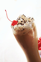 Capuccino frappe, cherry and whipped cream on top