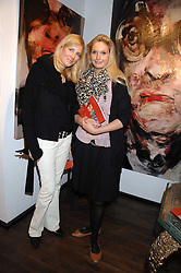 Left to right, CATHARINA LUEBKE-DETRING and KATHERINE HOEGER at a private view of paintings by Lita Cabellut and Russian artist Yuri Kuper at Opera Gallery, 134 New Bond Street, London on 2nd April 2008.<br />