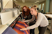 Students work in the Tech Style lab housed in the School of Fashion Design and Merchandising. The lab allows students to print fabric, embroider and even body scan for precise measurements.
