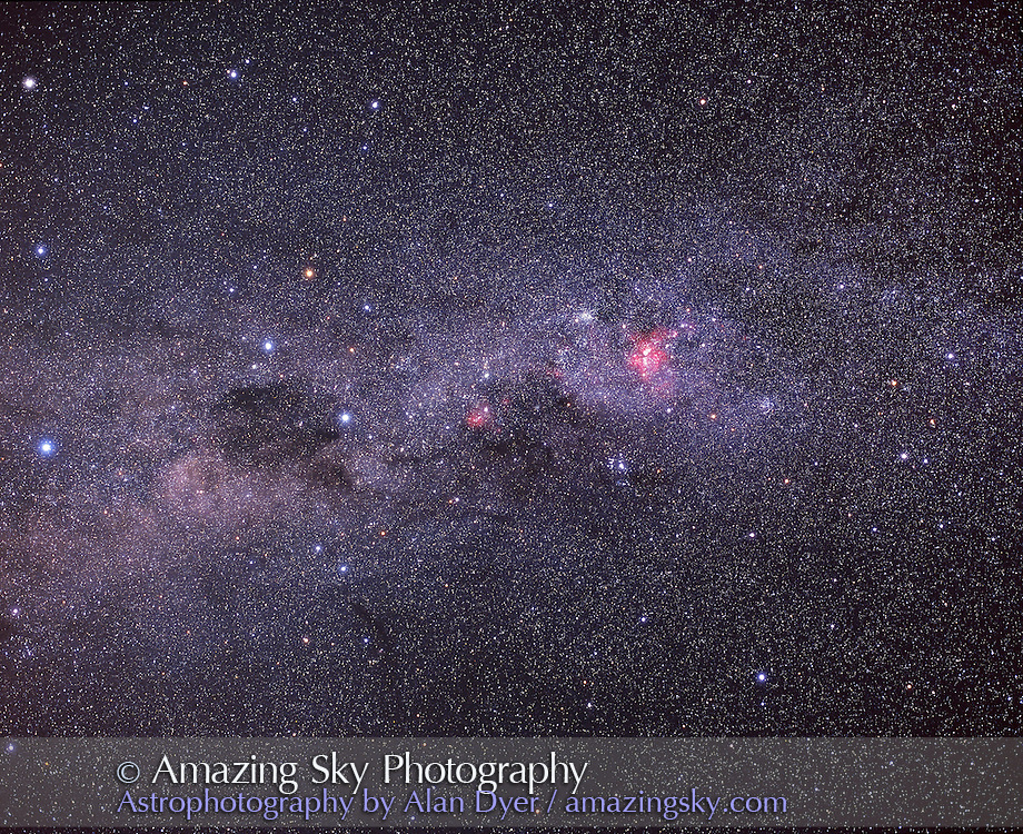 Southern Cross (Crux) and Eta Carina area of Carina the Keel in southern Milky Way. With Coal Sack to left of Crux...Pentax 67 camera with 90mm lens at f/4 with Fujichrome 400F slide film. About 15 minutes exposure. Tracked but not guided. Taken from near Ceduna, South Australia in December 2002. ..Scanned with Nikon 8000ED with SuperFine Mode and 16x sampling (best settings). No ICE...Glow layer added to add fuzz to bright stars.
