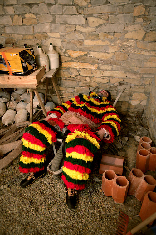 "One ""Careto"" lies knocked-out in the cellar. Most of men who wear this costume spend the day drinking red wine and scaring girls and women."