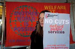 © under license to London News Pictures.  06/12/2010. A woman holds a sign in protest outside the Civic Centre today (Monday). People gather outside the Civic Centre in Plymouth to protest against public service cuts.
