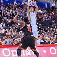 24 November 2013: Los Angeles Clippers small forward Jared Dudley (9) takes a jumpshot over Chicago Bulls small forward Luol Deng (9) during the Los Angeles Clippers 121-82 victory over the Chicago Bulls at the Staples Center, Los Angeles, California, USA.