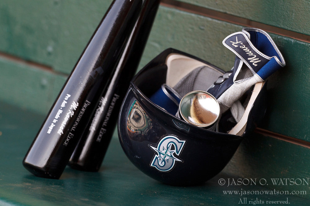 OAKLAND, CA - APRIL 07: Detailed view of a batting helmet and bats belonging to Munenori Kawasaki #61 of the Seattle Mariners (not pictured) before the game against the Oakland Athletics at O.co Coliseum on April 7, 2012 in Oakland, California. The Seattle Mariners defeated the Oakland Athletics 8-7. (Photo by Jason O. Watson/Getty Images) *** Local Caption ***