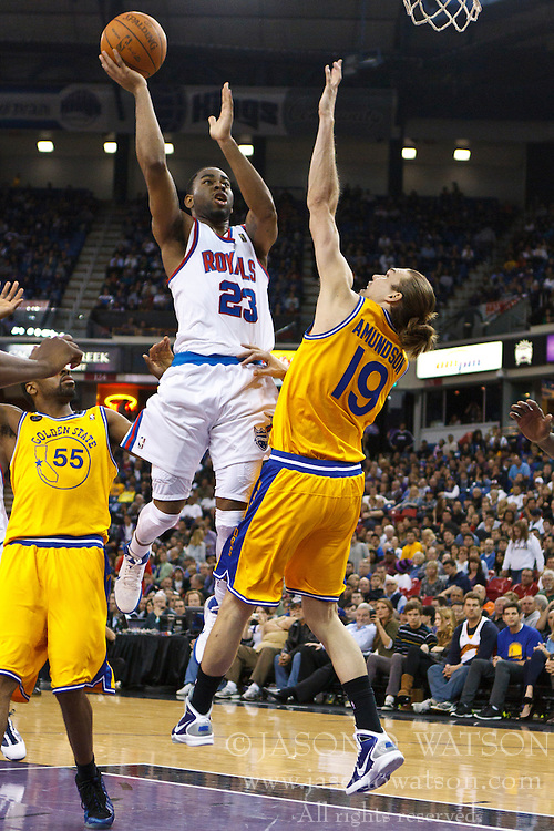 March 14, 2011; Sacramento, CA, USA;  Sacramento Kings guard Marcus Thornton (23) shoots over Golden State Warriors center Louis Amundson (19) during the fourth quarter at the Power Balance Pavilion. Sacramento defeated Golden State 129-119.