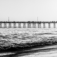 Orange County California pier panorama Picture black and white photography.  Balboa Pier is located on the Pacific Ocean on Balboa Peninsula in Newport Beach California. Panoramic photo ratio is 1:3.
