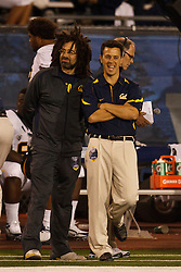 September 17, 2010; Reno, NV, USA; Counting Crows singer Adam Duritz watches the game on the California Golden Bears sidelines during the first quarter against the Nevada Wolf Pack at Mackay Stadium. Nevada defeated California 52-31.