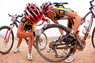GREYTON, SOUTH AFRICA - Christoph Sauser and Burry Stander fix and early morning flat on a day with many mechanicals during stage four of the Absa Cape Epic Mountain Bike Stage Race held in Greyton on the 25 March 2009 in the Western Cape, South Africa..Photo by Sven Martin /SPORTZPICS