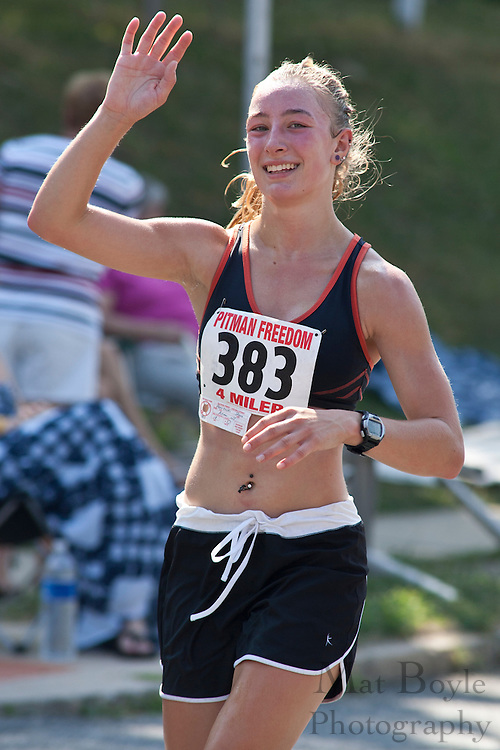 Shona Potrzuski, a 2010 Pitman High School graduate, waves to the camera during the 2010 Pitman Freedom 4 Mile race. Potrzuski is headed to St. Peters College in the fall on a track scholarship.