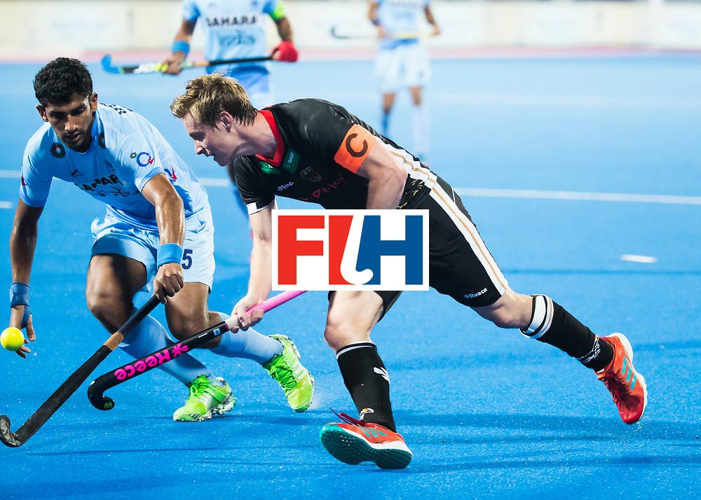 BHUBANESWAR - Hockey World League finals Match for bronze , Germany v India (1-2). Mats Grambusch (Ger) with Uthappa Sannuvanda (Ind)  . COPYRIGHT KOEN SUYK