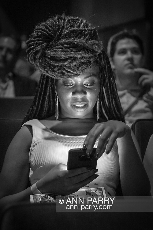 Bellmore, New York, USA. July 21, 2016. Actress   Kelli Vonshay Henderson - in audience before start of the 19th Annual Long Island International Film Expo Awards Ceremony, LIIFE 2016, held at the historic Bellmore Movies. LIIFE was called one of the 25 Coolest Film Festivals in the World by MovieMaker Magazine. (Black and White)