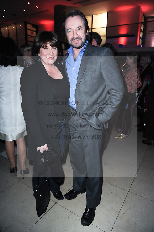 Actress CAROLINE QUENTIN and actor NEIL PEARSON at the Costa Book Awards 2009 held at Quaglino's, 16 Bury Street, London SW1 on 26th January 2010.