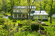 A view of the farmhouse in spring at Firefly Farm Firefly Farm, Hauverville, New York, U.S.A.